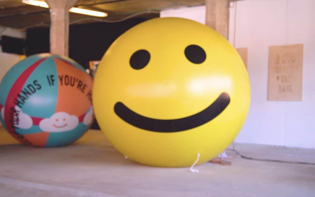 Photo of giant smiley face at Happniess HQ, Denver 2018 as part of Happt City Denver